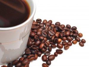 7594690-bianco-tazza-di-caffe-e-chicchi-di-caffe